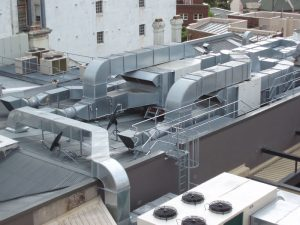 complex interconnecting air ducting on a roof top
